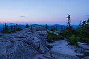 Silhouette of mountain range at sunset from Middle Sister Mountain in Albany, New Hampshire USA during the summer months,