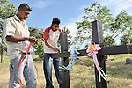 Exactly ten years later, Sergio Gutierrez (left) and his brother Marlon decorate crosses that mark the site where they believe their two sisters, ten year old Isaura and 11 year old Cristina, were buried when Hurricane Mitch caused a mudslide on the slopes of Nicaragua's Casita Volcano that swept through two villages below, killing more than 2,000 people. A ceremony to remember the dead was held on the slopes of the mountain on the anniversary of the tragedy.