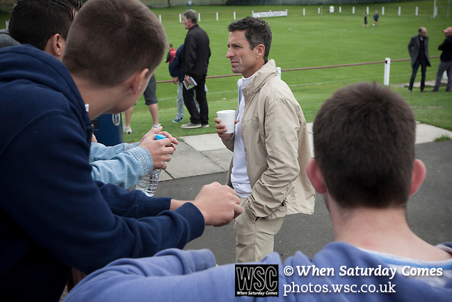Whitehill Welfare 4 Gala Fairydean Rovers 2, 10/08/2013. Ferguson Park, Scottish Lowland Football League. Former Scotland internationalist and club ambassador John Collins chatting to fans at half-time during Gala Fairydean Rovers inaugural match in the Scottish Lowland Football League away to Whitehill Welfare at Ferguson Park. Gala were formed in 2013 by an a re-amalgamation of Gala Fairydean and Gala Rovers, the two clubs having separated in 1908 and Gala's Netherdale ground in Galashiels in the Scottish Borders had one of only two stands designated as listed football stands in Scotland. Whitehill won the match, the first-ever in the newly-formed Lowland League by 4 goals to 2. Photo by Colin McPherson.