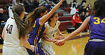 Ketchikan's Brittany Slick dribbles through Lathrop defenders in their Dimond Lady Lynx Prep Shootout basketball game Friday, February 10, 2017.  Photo for the Daily News by Michael Dinneen
