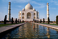 Agra, India, January 1975: Taj Mahal is a white marble mausoleum built by Mughal emperor Shah Jahan in memory of his third wife, Mumtaz Mahal located in Agra, India. Taj Mahal is the finest example of Mughal architecture, a style that combines elements from Persian, Turkish and Indian architectural styles and also considered as one of the seven wonders of the world. In 1983, the Taj Mahal became a UNESCO World Heritage Site.