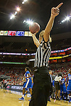 Referee Dee Kantner holds the ball for UK after a timeout was called. in Louisville, Ky., on Sunday, December, 2, 2012. Photo by James Holt | Staff