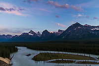 The waxing gibbous Moon over the Rocky Mountains and Athabasca River from the overlook south of  Jasper National Park, Alberta, Canada, in evening twilight. Metered exposure with the Canon 7D and 10-22mm lens.
