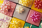 Colorful gifts with bows and ribbons celebrating a birthday, a shower, a wedding, a baby shower, a graduation, an anniversary.
