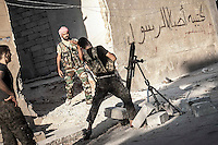 Rebel fighters belonging to the Kateba Omar Ben Abdul Aziz launch a mortar rocket as they carry out a military operation to push back the Assad troops from the first line of fire in Aamria battlefield at the southwest of Aleppo City..
