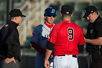 Lakewood BlueClaws manager Marty Malloy (2) exchanges lineup cards with Kannapolis Intimidators manager Justin Jirschele (9) and umpires Aaron Schorch (left) and Mike Rains (right) prior to the South Atlantic League game at Kannapolis Intimidators Stadium on April 8, 2017 in Kannapolis, North Carolina.  The BlueClaws defeated the Intimidators 8-4 in 10 innings.  (Brian Westerholt/Four Seam Images)