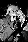 December 31, 1986:  Andy Warhol blows a noise maker and celebrates his last New Year's Eve with a dinner at Cafe Roma restaurant in New York City, New York.  Warhol died less than two months later on February 22, 1987..