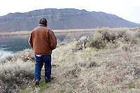 """Rex Buck Jr., leader of the Wanapum Indians, walks along the banks of the Columbia River south of the Wanapum Dam on February 3, 2011.  """"The river flows in us and we're a part of the river and we're also a part of this land.""""  said Buck.  The Wanapum Indians had never moved onto a reservation but negotiated peacefully with a power company to remain on their land.  (photo credit Karen Ducey)"""