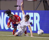 Amy LePeilbet, right, of the United States collides with Mariela Campos of Costa Rica during play in the CONCACAF Olympic Qualifying semifinal match at BC Place in Vancouver, B.C., Canada Friday Jan. 27, 2012. The United States won the match 3-0 to earn a berth in 2012 London Olympics.
