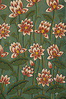 Patterns of lotus flowers and leaves painted on the walls of the Jaipur City Palace, Jaipur, Rajasthan, India.