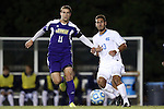 20 November 2014: James Madison's Josh Grant (ENG) (11) and North Carolina's Raby George (SWE) (33). The University of North Carolina Tar Heels hosted the James Madison University Dukes at Fetzer Field in Chapel Hill, NC in a 2014 NCAA Division I Men's Soccer Tournament First Round match. UNC won the game 6-0.