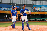 17 August 2007: Catchers Boris Marche and Jamel Boutagra practice during the Good Luck Beijing International baseball tournament (olympic test event) at the Wukesong Baseball Field in Beijing, China.