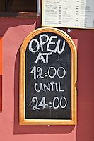 Restaurant board with open hours of restaurant