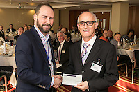 NCBC President James Simmonds hands over the proceeds from the club's Christmas lunch raffle which raised £2,000 for Double Impact to the organisation's Graham Miller