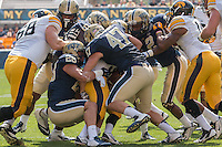 The Pitt Panthers gang tackle an Iowa ball carrier. Pictured are Anthony Gonzalez (28), Matt Galambos (47) and Terrish Webb (2). Iowa Hawkeyes defeated the Pitt Panthers 24-20 at Heinz Field, Pittsburgh Pennsylvania on September 20, 2014.