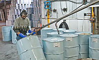 Danny Ayotte fills drums with Maple syrup, prepping it for pasteurization at the International Strategic Reserve in Saint-Antoine-de-Tilly, 40km South-West of Quebec City Wednesday March 30, 2011. Asian market is going to buy Maple Syrup at a premium and Canada is ready to cash in.
