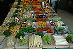Assorted salad vegetables for sale displayed on market stall in vegetable market, Viktualienmarkt, Munich, Germany.