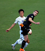 Ben Harris tries to control the ball under pressure from Takuya Iwata during the Oceania Football Championship final (second leg) football match between Team Wellington and Auckland City FC at David Farrington Park in Wellington, New Zealand on Sunday, 7 May 2017. Photo: Mike Moran / lintottphoto.co.nz