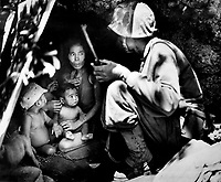 A member of a Marine patrol on Saipan found this family of Japs hiding in a hillside cave.  The mother, four children and a dog, took shelter from the fierce fighting in that area.  June 21, 1944. Cpl. Angus Robertson. (Marine Corps)<br /> Exact Date Shot Unknown<br /> NARA FILE #:  127-GR-113-83266<br /> WAR &amp; CONFLICT BOOK #:  1267