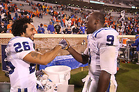 Duke wide receiver Donovan Varner (26) celebartes with Duke quarterback Thaddeus Lewis (9) during an ACC football game against Virginia Saturday in Charlottesville, VA. Duke won 28-17. Photo/Andrew Shurtleff