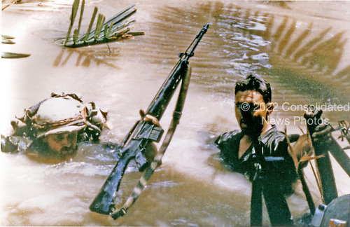 """Mekong Delta, Vietnam - April 7, 1968 -- United States Army """"B"""" Company, Third Batallion, 47th Infantry, 9th Infantry Division personnel crossing a very deep river in the Mekong Delta, Vietnam on April 7, 1968.  The swimmers assisted the non-swimmers during the crossing..Credit: Dennis Kurpius - U.S. Army via CNP"""