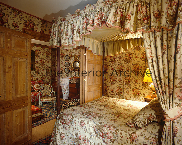 This classically English four-poster bedroom and adjacent sitting room is decorated in a Geoffrey Bennison chintz