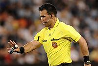 Referee Hikario  Grajeda holding field marker spray... Sporting Kansas City defeated Real Salt Lake 2-0 at LIVESTRONG Sporting Park, Kansas City, Kansas.