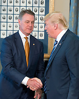 United States President Donald J. Trump shakes hands with US Senator David Perdue (Republican of Georgia) prior to signing three Executive Orders concerning financial services at the Department of the Treasury in Washington, DC on April 21, 2017.<br /> Credit: Ron Sachs / Pool via CNP /MediaPunch