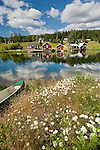 A canoe awaits a rider on a beautiful summer day on the waterway in Fallesvikshamn near Nordingra on the Baltic coast.
