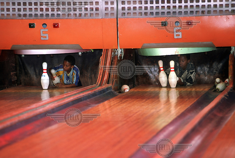 Asmara's tenpin bowling alley is one of the few remaining examples in the world of a 1950s alley. The automatic skittle reloading system has been broken for years, so instead young boys are paid to reload after each strike. Asmara is a showcase of 1930s Italian Art Deco architecture. Initially created by colonial-era Italians, the style continued to flourish in the 1960s as local architects carried on the tradition.