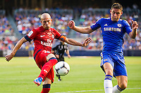 Christophe Jallet (26) of Paris Saint-Germain is marked by Gary Cahill (24) of Chelsea FC. Chelsea FC and Paris Saint-Germain played to a 1-1 tie during a 2012 Herbalife World Football Challenge match at Yankee Stadium in New York, NY, on July 22, 2012.
