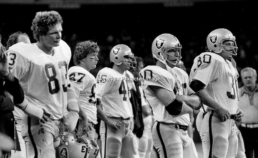 Oakland Raiders sideline after loss..Ted Hendricks, Dave Casper, Pete Banazak, and Mark van Eeghen.<br />