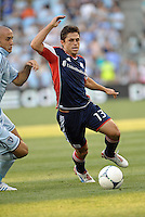 Ryan Guy (13) midfield New England Revolution in action..Sporting Kansas City and New England Revolution played to a 0-0 tie at LIVESTRONG Sporting Park, Kansas City, KS.