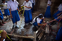 Children move pieces of timber to the new site of the Kartini Emergency School. In September 2007 city authorities evicted the school from its location under a Norht Jakarta highway. Undaunted, students and the 'Twin Teachers' moved the school piece by piece to its new temporary home. Since the early 1990s, twin sisters Sri Rosyati (known as Rossy) and Sri Irianingsih (known as Rian) have used their family inheritance to set up and run 64 schools in different parts of Indonesia, providing primary education combined with practical skills to some of the country's most deprived children.