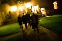 Students and faculty members wearing black gowns cross the main yard at Magdalene College in Cambridge, United Kingdom, to reach the dinning hall, 10 March 2007.