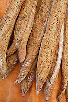 Freshly-baked multigrain French bread baguettes on sale at food market in Bordeaux region of France