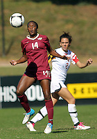 COLLEGE PARK, MD - OCTOBER 21, 2012:  Domenica Hodak (2) of the University of Maryland watches Tiffany McCarty (14) of Florida State bring down a high ball during an ACC women's match at Ludwig Field in College Park, MD. on October 21. Florida won 1-0.