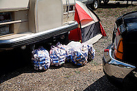 Trash bags filled with empty beer cans lie on the ground in the campground at the Testicle Festival at the Rock Creek Lodge in Clinton, MT.  The Rock Creek Lodge in Clinton, MT, has hosted the annual Testicle Festival since the early 1980s.  The four day festival and party revolves around the consumption of so-called Rocky Mountain Oysters, which are deep-fried bull testicles.