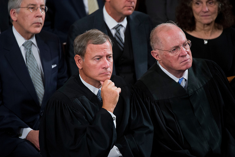 UNITED STATES - SEPTEMBER 24: Supreme Court Chief Justice John Roberts, left, and Justice Anthony Kennedy, attend an address by Pope Francis to a joint meeting of Congress in the House chamber of the Capitol, September 24, 2015. Francis is the first pope to ever address Congress. (Photo By Tom Williams/CQ Roll Call)