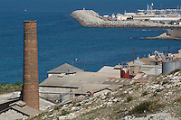 19th century style chimney of an industrial site by the seaside of Les Goudes, Marseille, France.