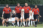 28 September 2014: Match officials. From left: Assistant referee Paul Putnam, fourth official Matt Englebert, referee John Douglas, and assistant referee Michael Rhinehart. The Wake Forest University Demon Deacons hosted the Notre Dame University Fighting Irish at W. Dennie Spry Soccer Stadium in Winston-Salem, North Carolina in a 2014 NCAA Division I Women's Soccer match.