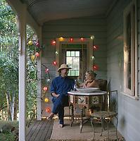 Designer Miv Watts and her partner Mike Gurney on the veranda of their Australian holiday home