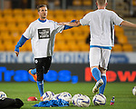 St Johnstone v Motherwell....31.10.14   SPFL<br /> Chris Millar warms up with Brian Easton wearing The Colours of our Scarves t-shirts<br /> Picture by Graeme Hart.<br /> Copyright Perthshire Picture Agency<br /> Tel: 01738 623350  Mobile: 07990 594431