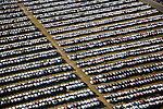 Corporate photography commissions for JM Family Enterprises' newly constructed vehicle distribution campus; Southeast Toyota Distributors; Southeast Transportation System. Over 95 large scale photographs for corporate offices and common areas. Abstract photography representing architecture, workspace, and the site of a 250 acre / 9 building vehicle processing and distribution facility.