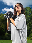 Expressive portrait of a teenage girl with a glove practicing baseball in summer