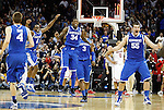 The UK wildcats celebrate as the buzzer sounds marking UK's Sweet 16 NCAA tournament win, 62-60 against 1 seed Ohio State at the Prudential Center in Newark, New Jersey on Friday, March 25, 2011.  Photo by Britney McIntosh | Staff