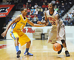 "Ole Miss' Jarvis Summers (32) is defended by McNeese State's Dontae Cannon (5) at the C.M. ""Tad"" Smith Coliseum in Oxford, Miss. on Tuesday, November 20, 2012. .."
