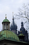 Kracow, Poland; Domed and spired Basilica of the Virgin Mary church, and the corner of the Wawel Castle; rooftops.