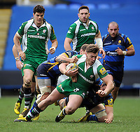 Johnny Williams of London Irish is tackled to ground. Aviva Premiership match, between London Irish and Worcester Warriors on February 7, 2016 at the Madejski Stadium in Reading, England. Photo by: Patrick Khachfe / JMP