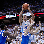 Kentucky Wildcats guard Jarrod Polson (3) guards North Carolina Tar Heels forward James Michael McAdoo (43) during the UK men's basketball vs. North Carolina at the Dean Smith Center in Chapel Hill, N.C., on Saturday, December 14, 2013. Photo by Emily Wuetcher | Staff